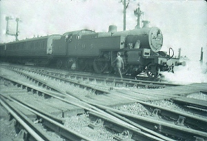 An LMS 2-6-4T carries out a shunting manouvre at the south end of station avoiding line. The LNWR signals lasted until the late 1970s.