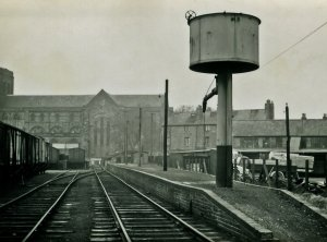 Around 1950 period, the water column was removed to the preserved Kent & East Sussex Railway in the late 1960s. The derelict wagons on the right were used for storage by the WD.
