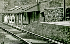 The ramshackle station building from the Colonel stephens Era, showing the ramp up to the platform.